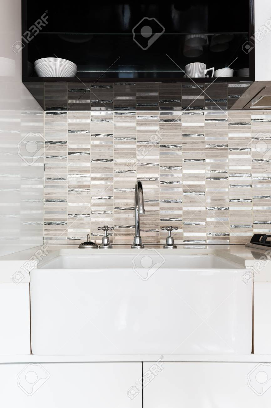 Close Up Of A Deep White Kitchen Sink And Feature Tiled Splashback Stock  Photo   72520231