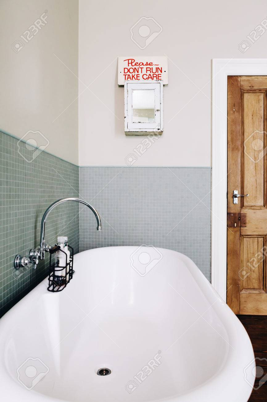 Vintage Style Bathroom With Quirky Retro Safety Sign On An Old ...
