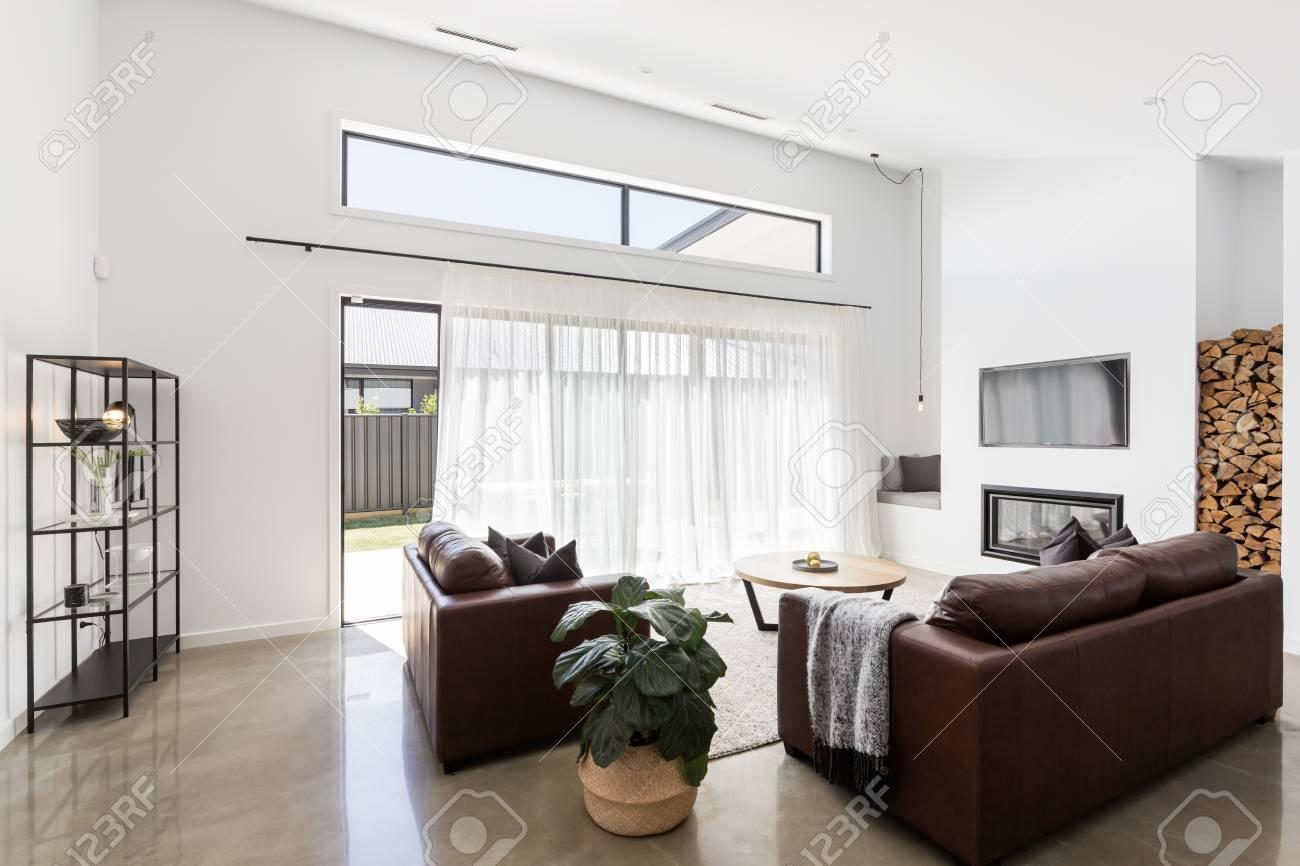 Modern open plan luxury living room with glass sliding doors