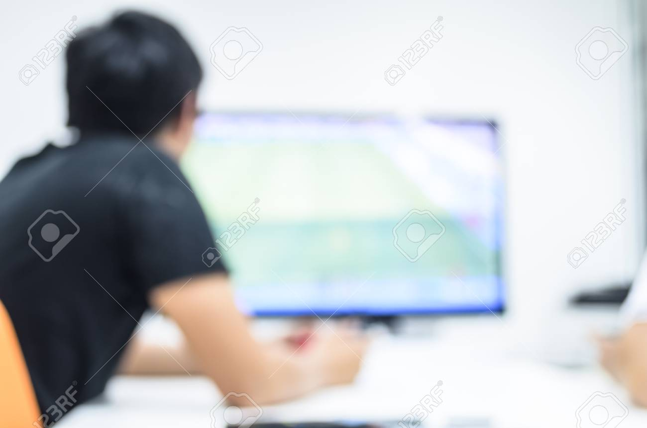 A man has playing fooball game via television and video game