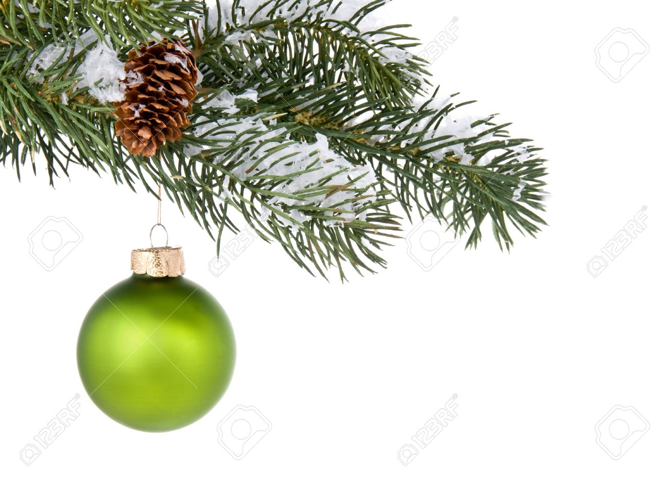 Green Christmas Tree Ornament Hangs From A Pine Tree Branch On ...
