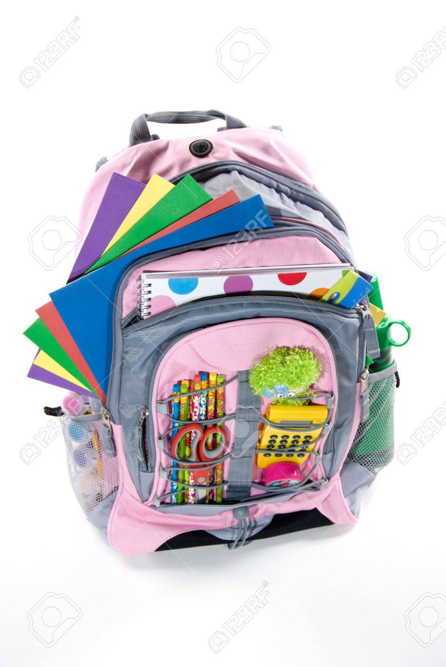 Pink book bag is filled with a student's school supplies Stock Photo - 1951791
