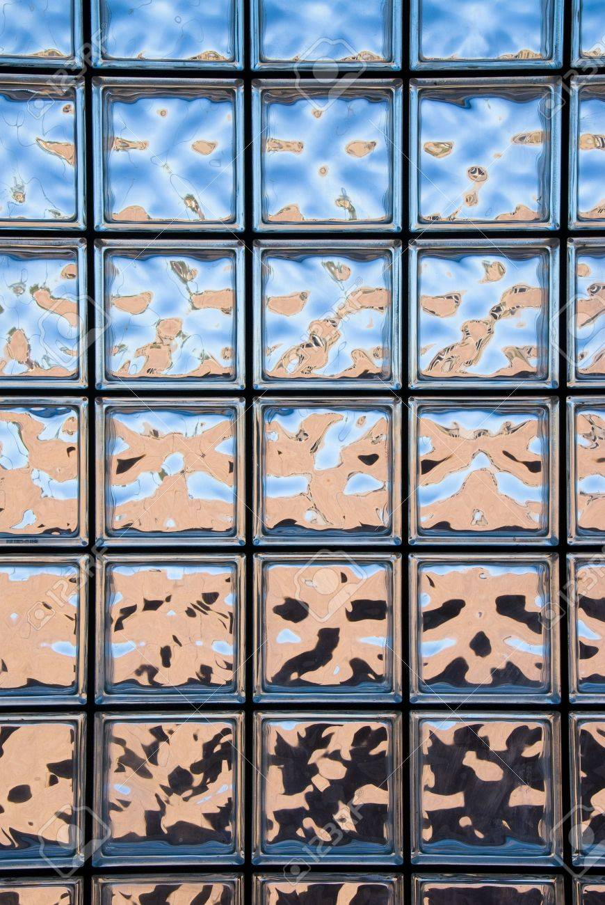 A Glass Block Window Looking Outside Of A Custom Home Shows The