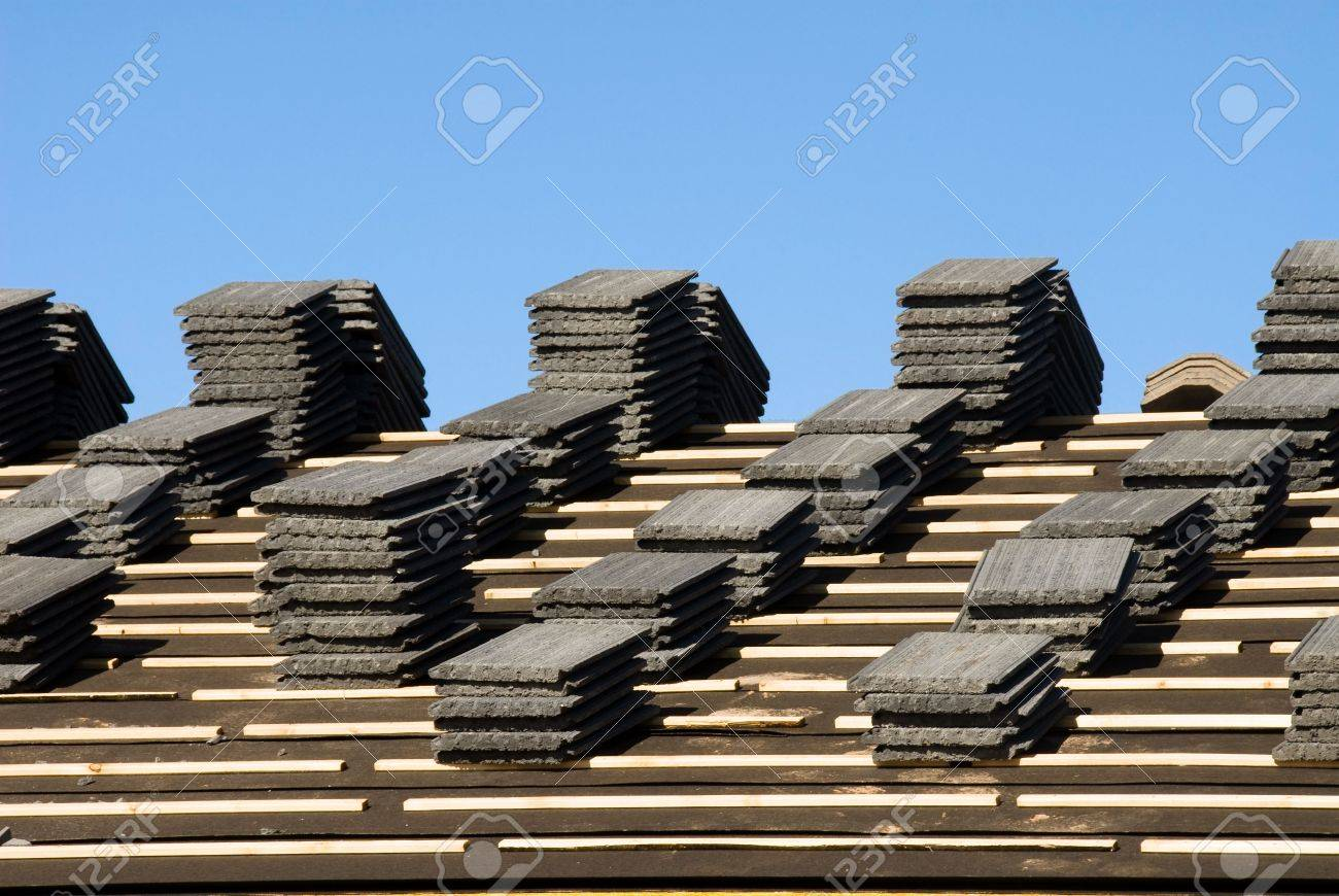 Image Shows A Home Under Construction At The Roofing Phase. Ideal For Roofing  Advertising And