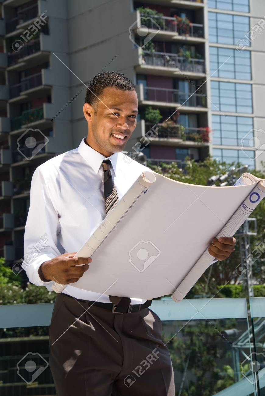 A male Africian American architect executive reviews specifications for a project. Stock Photo - 3820293