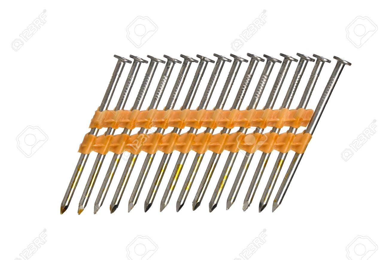A Row Of Nail Gun Nails Isolated On A White Background. Stock Photo ...