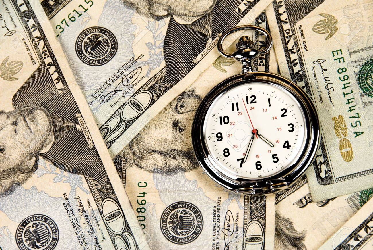 A pocket watch, or clock, timepiece on a pile of cash. Good use for any financial inference where time is a factor of money, investment and growth. - 4869528