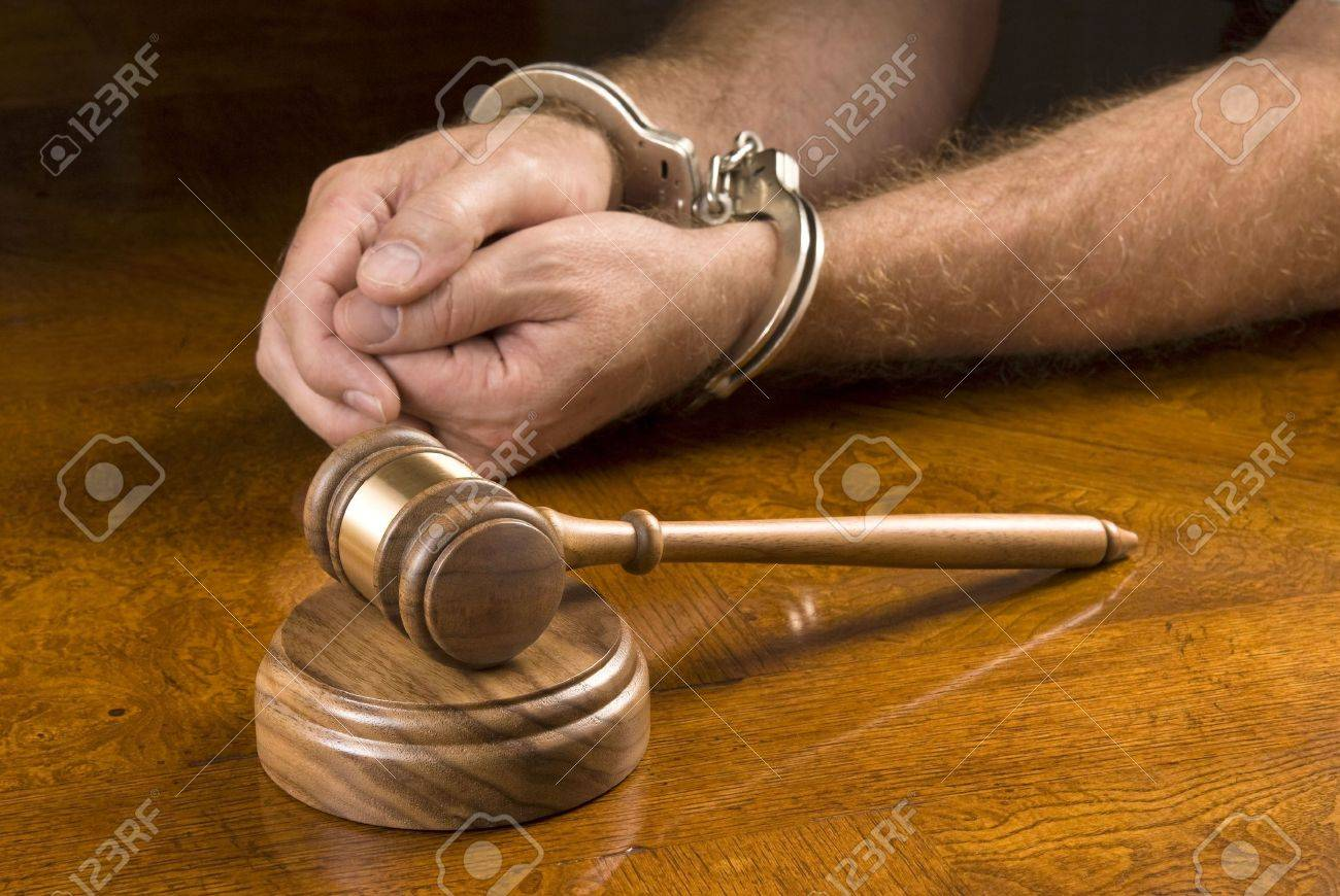 A man arrested awaits the judge to use his gavel to render a decision. Stock Photo - 5541502
