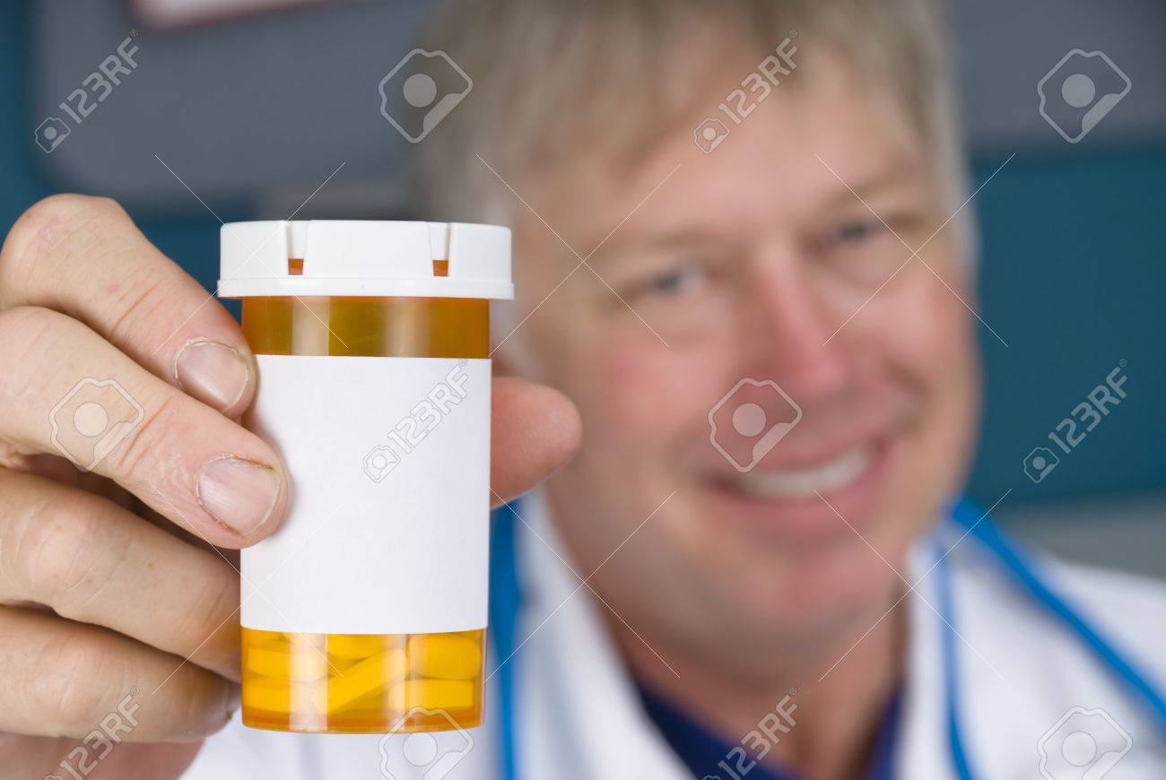 A pharmacist doctor holds up a pill bottle. Label is left blank for copy. Stock Photo - 5529864
