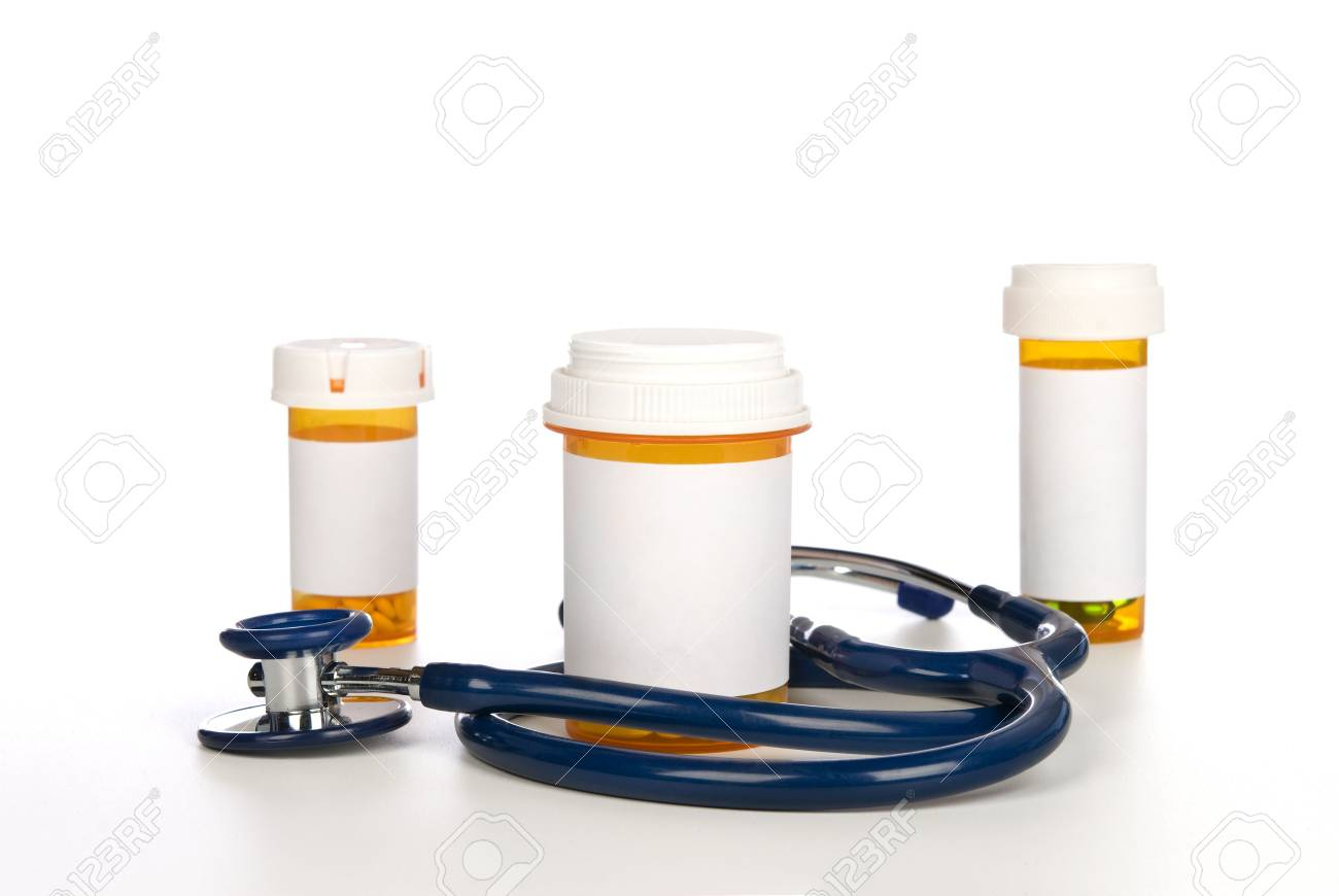 Prescription pill bottles with copy space surrounded by a stethoscope. Stock Photo - 5541453