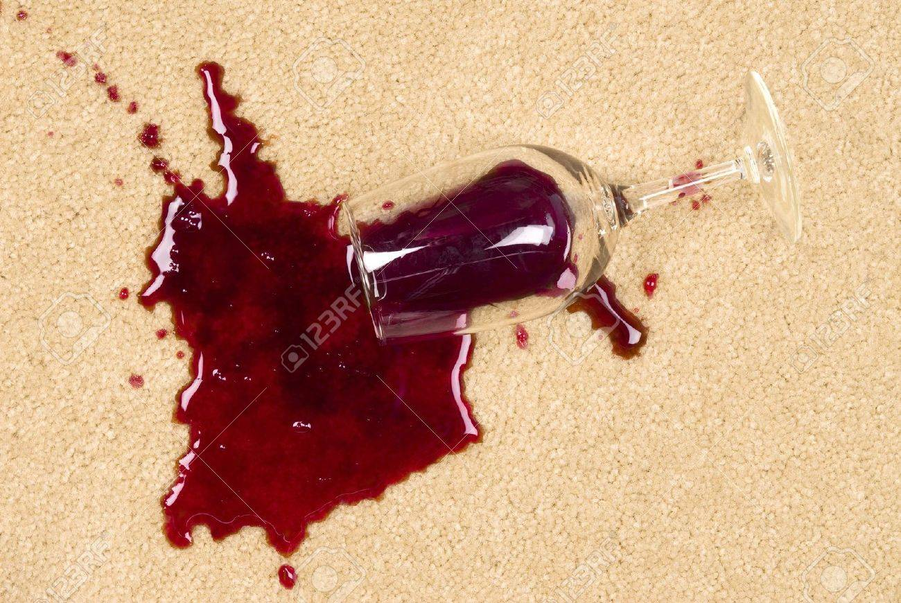A glass of spilled wine on brand new carpet is sure to leave a stain. Stock Photo - 5885578
