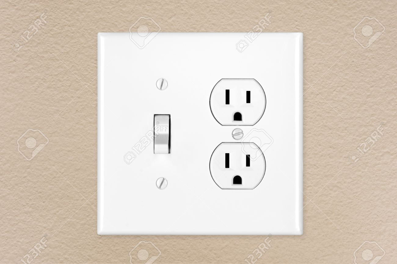 A brand new modern electrical toggle light switch and power outlet a brand new modern electrical toggle light switch and power outlet on a freshly painted wall aloadofball Gallery