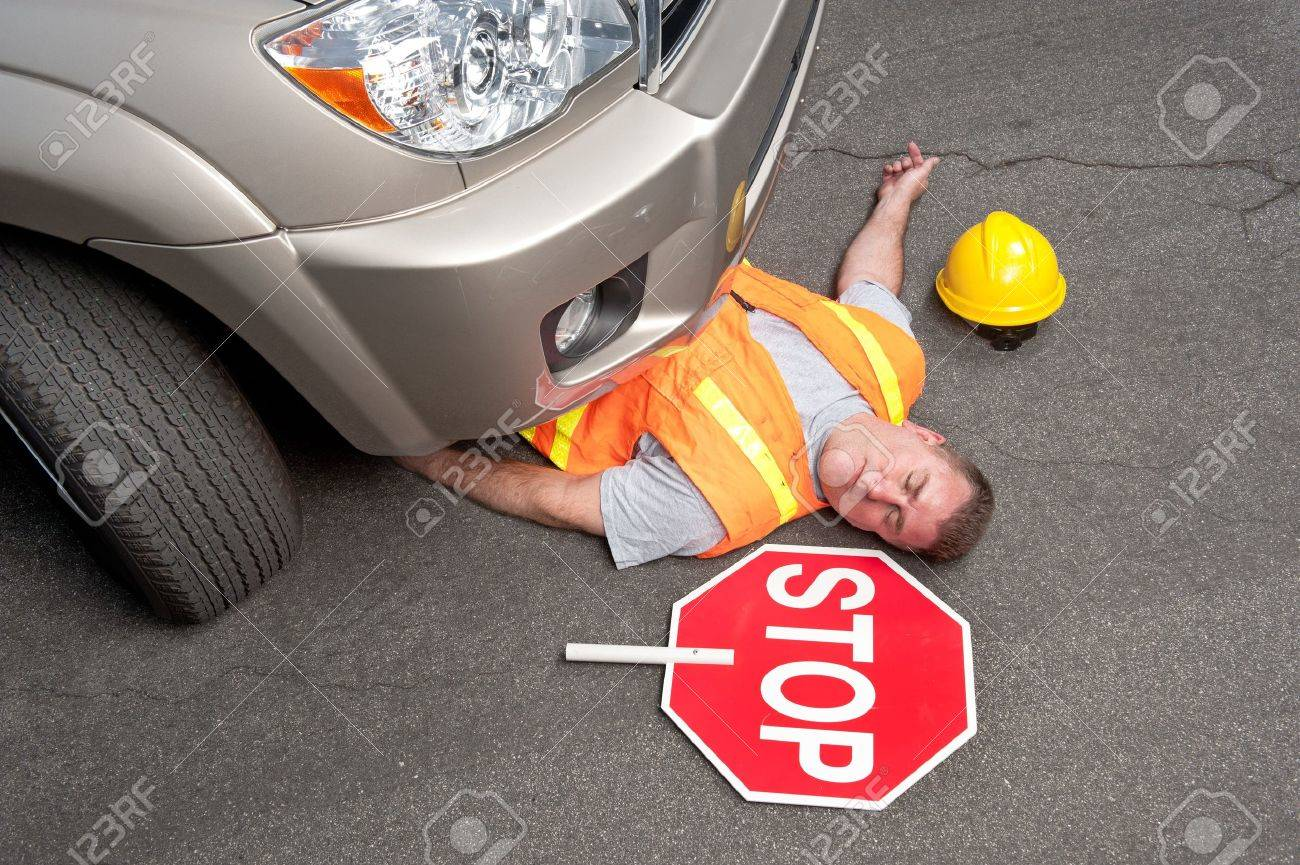 A road worker is hit by a car. - 10101258