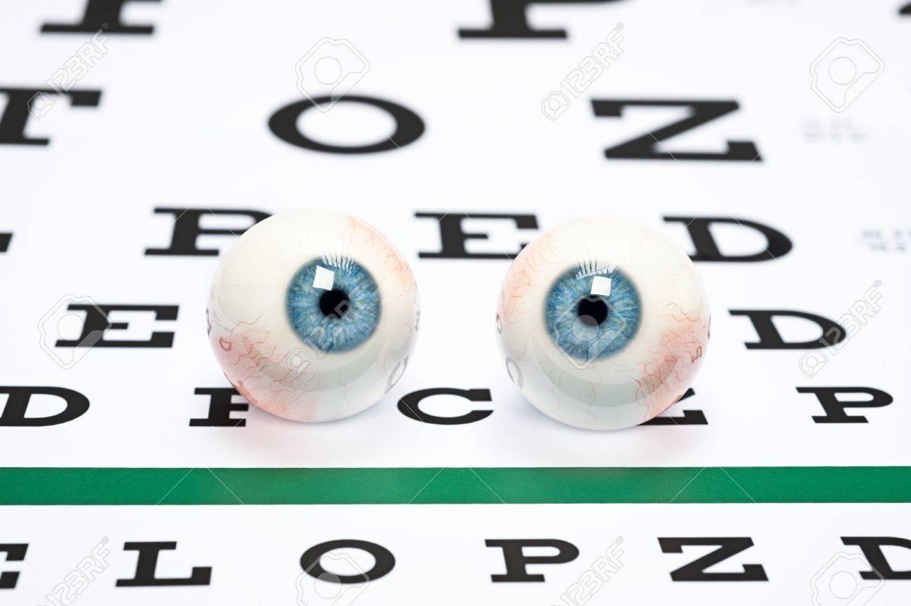 A pair of prosthetic eyeballs on a snellen eye chart stock photo a pair of prosthetic eyeballs on a snellen eye chart stock photo 12769882 geenschuldenfo Choice Image