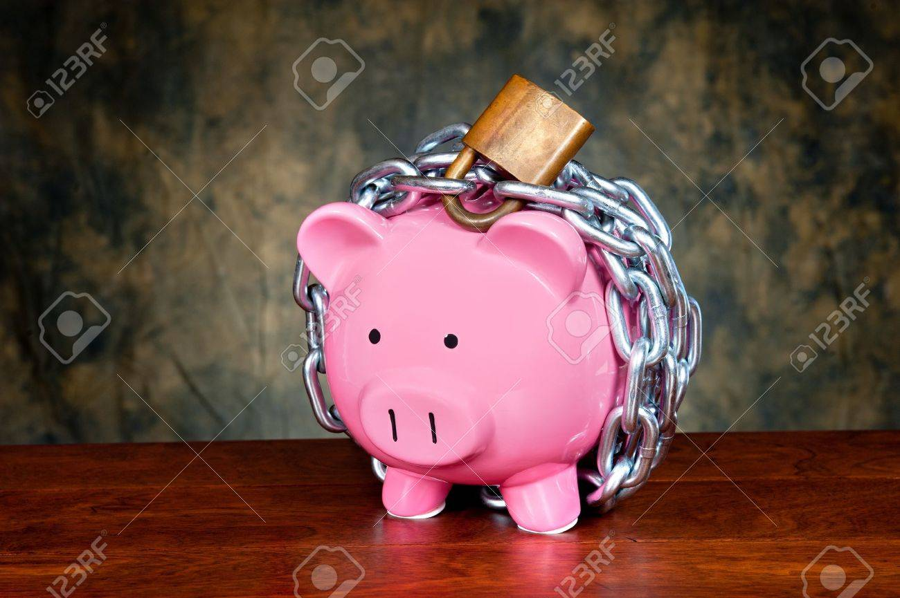 A pink piggybank chained up and locked. Image can be used for financial protection inferences or other investment messages. Stock Photo - 13998389
