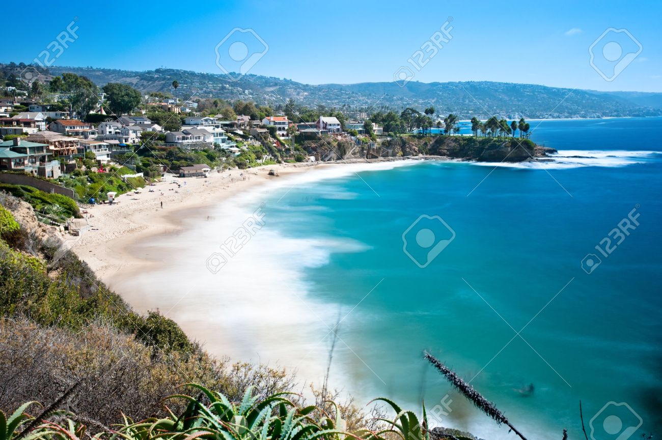 An image of a beautiful cove called Crescent Bay in Laguna Beach, California. Shot with a slow shutter to capture the water motion on a bright sunny day. - 16106521