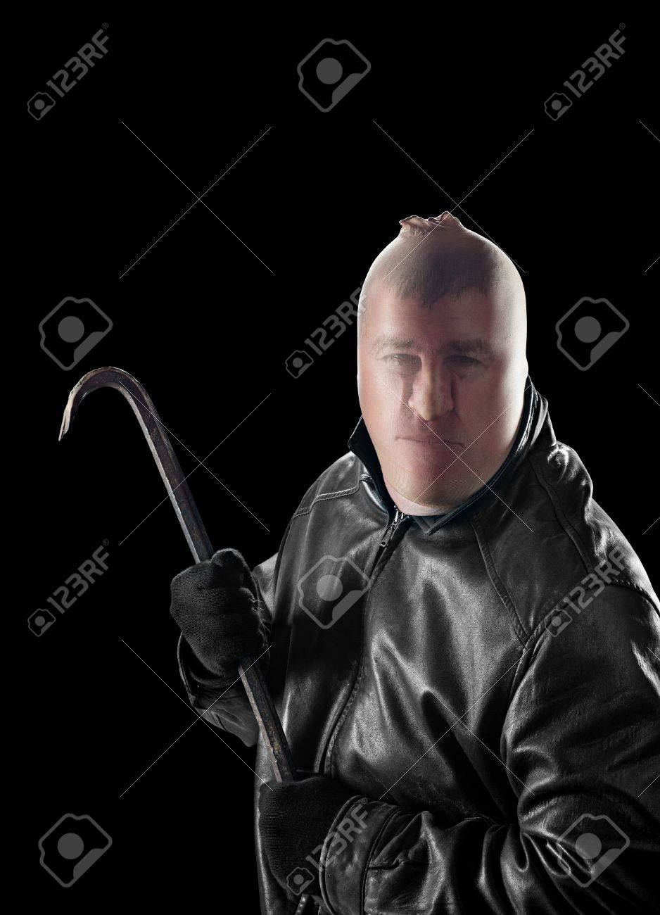 A criminal wearing pantyhose over his head to hide his identity carries a crowbar to commit a crime. Stock Photo - 16037317
