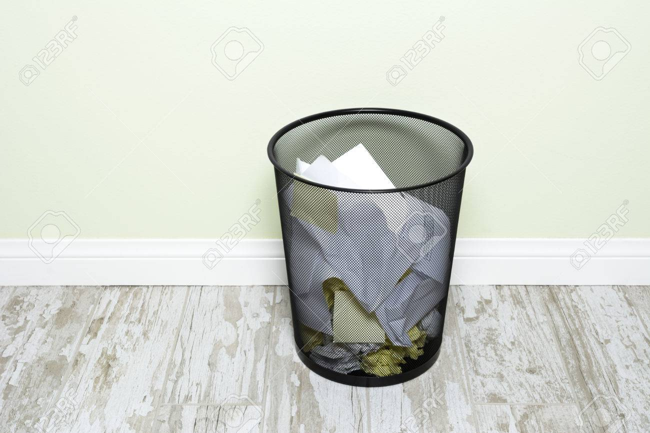 An Office Trashcan Filled With Wads Of Crumpled Paper, Sticky Notes And  Folded Paper.