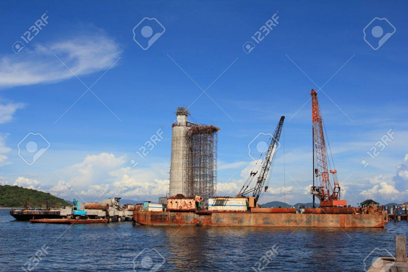 the lighthouse under construction and cranes under a blue sky Stock Photo - 10540336