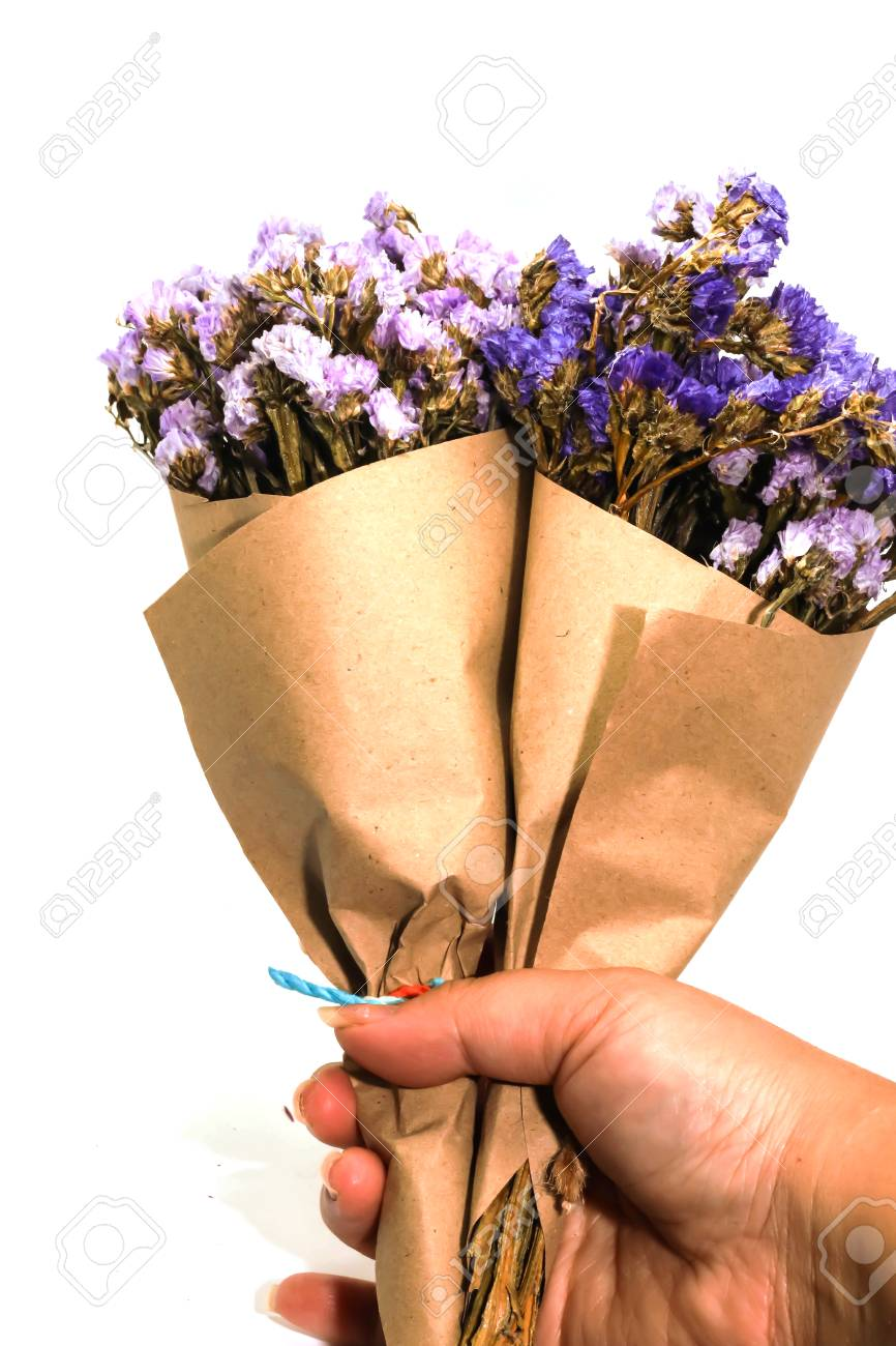 Close Up Two Brown Bouquet Purple Statice Dry Flower On Hand Stock Photo Picture And Royalty Free Image Image 95427776