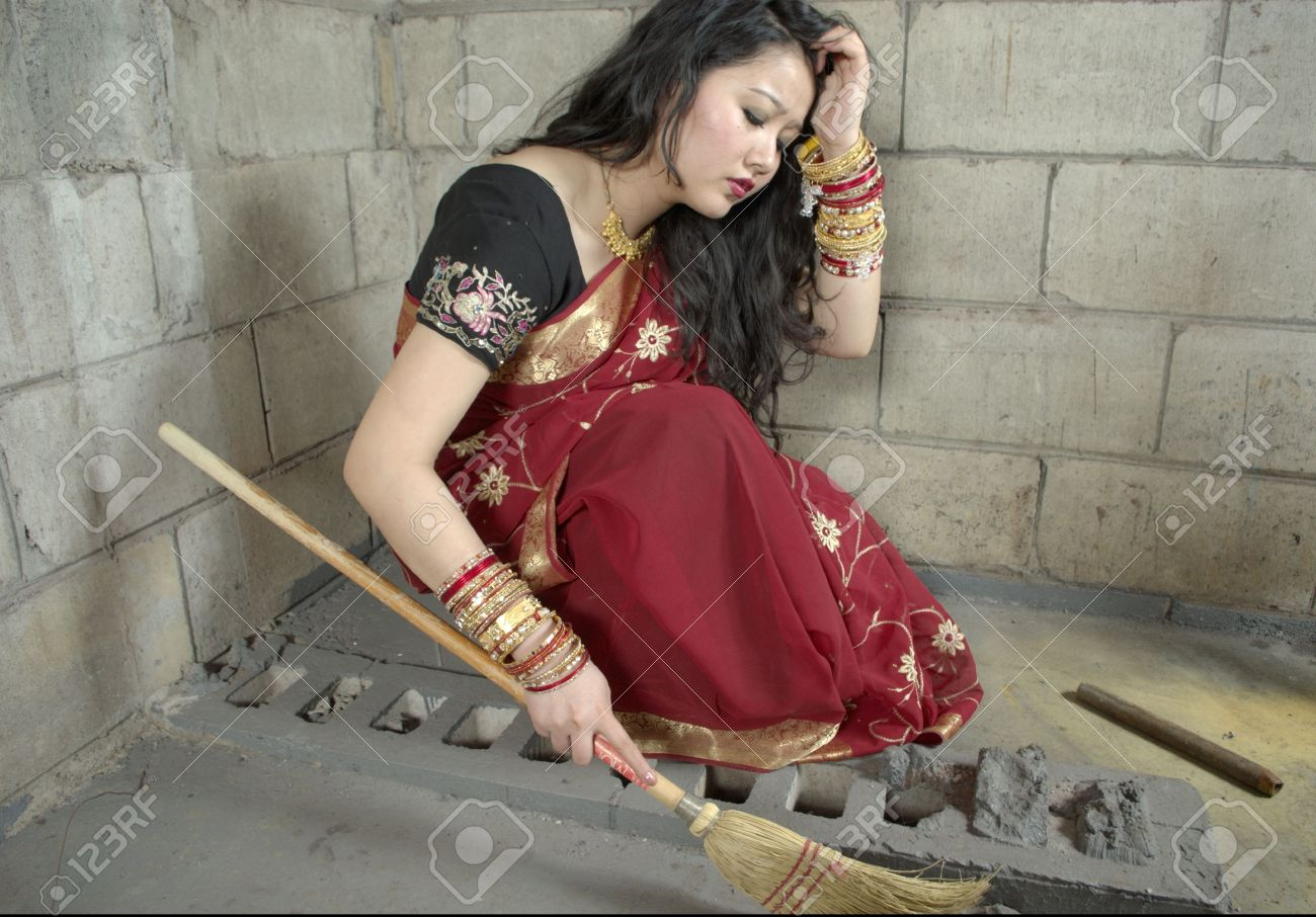 indian woman holding broom sweeping while wearing sari and bangles. Stock Photo - 5906628