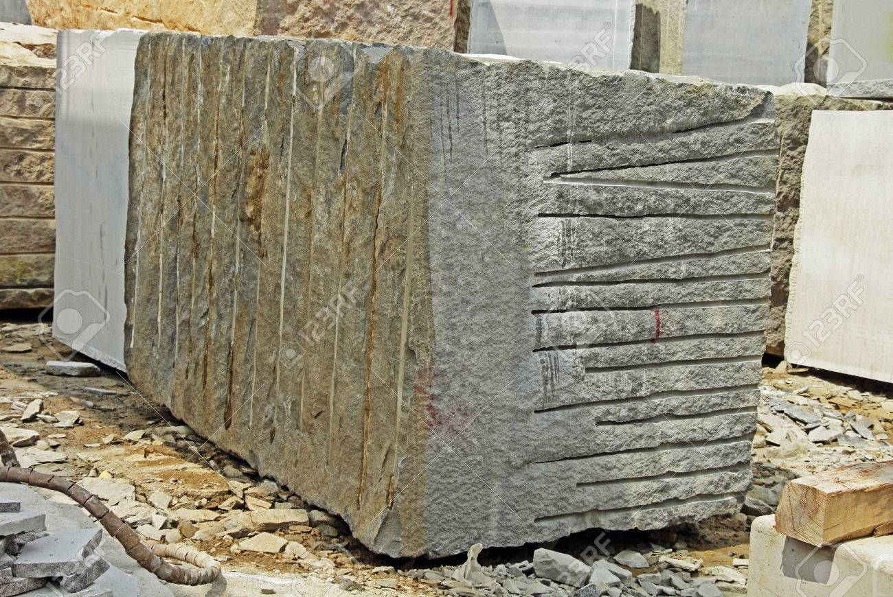 Huge Indian granite block stacked in a stone processing factory for cutting and polishing into flooring
