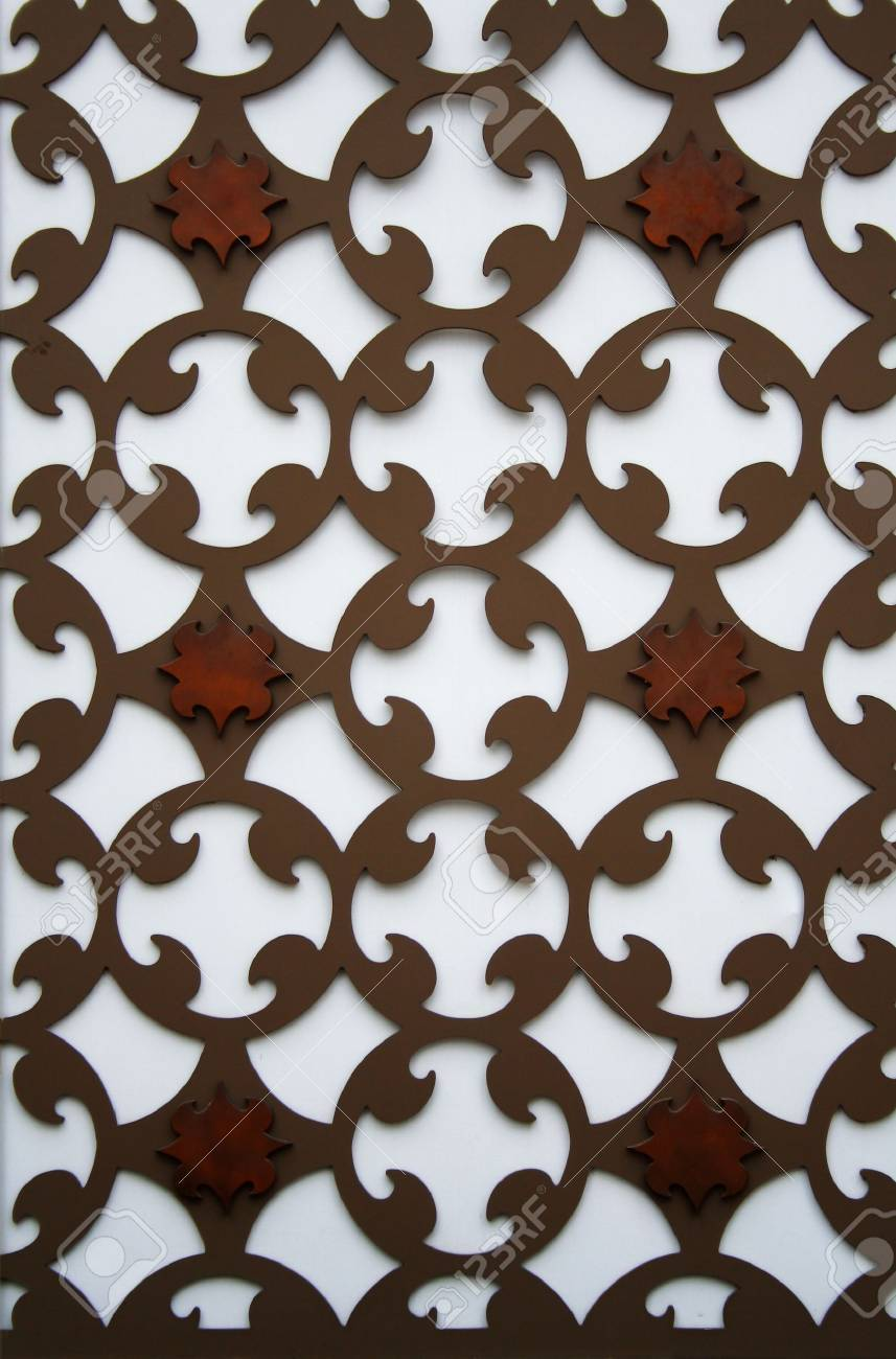 A new perforated pattern metal plate on a wall Stock Photo - 10841086