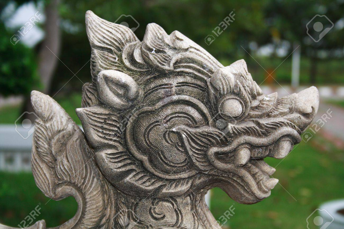 A Beautiful Sand Stone Lion Statue Of Thai Fairy Tale In A Temple Garden  Stock Photo