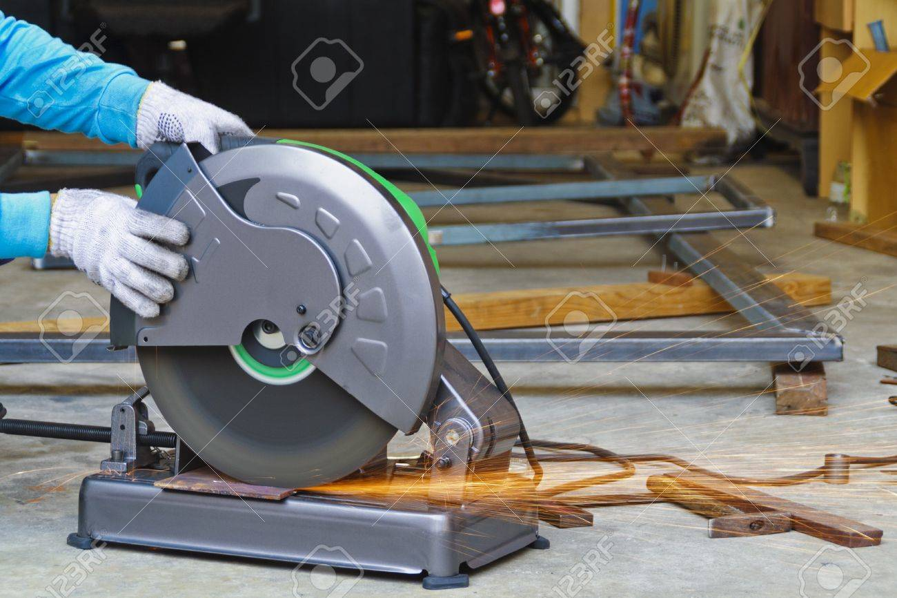 Construction working with cutting grinder Stock Photo - 14394877