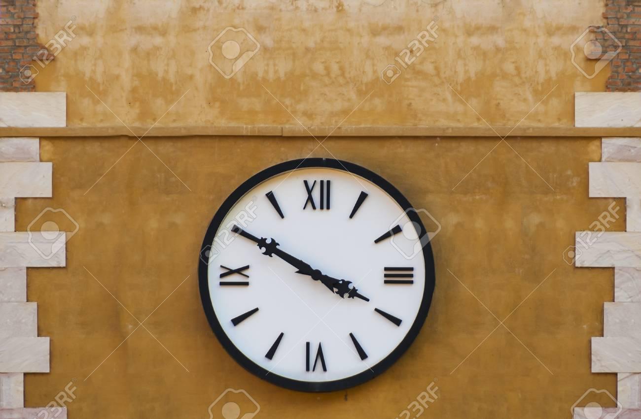 Retro clock on a wall Stock Photo - 14868205