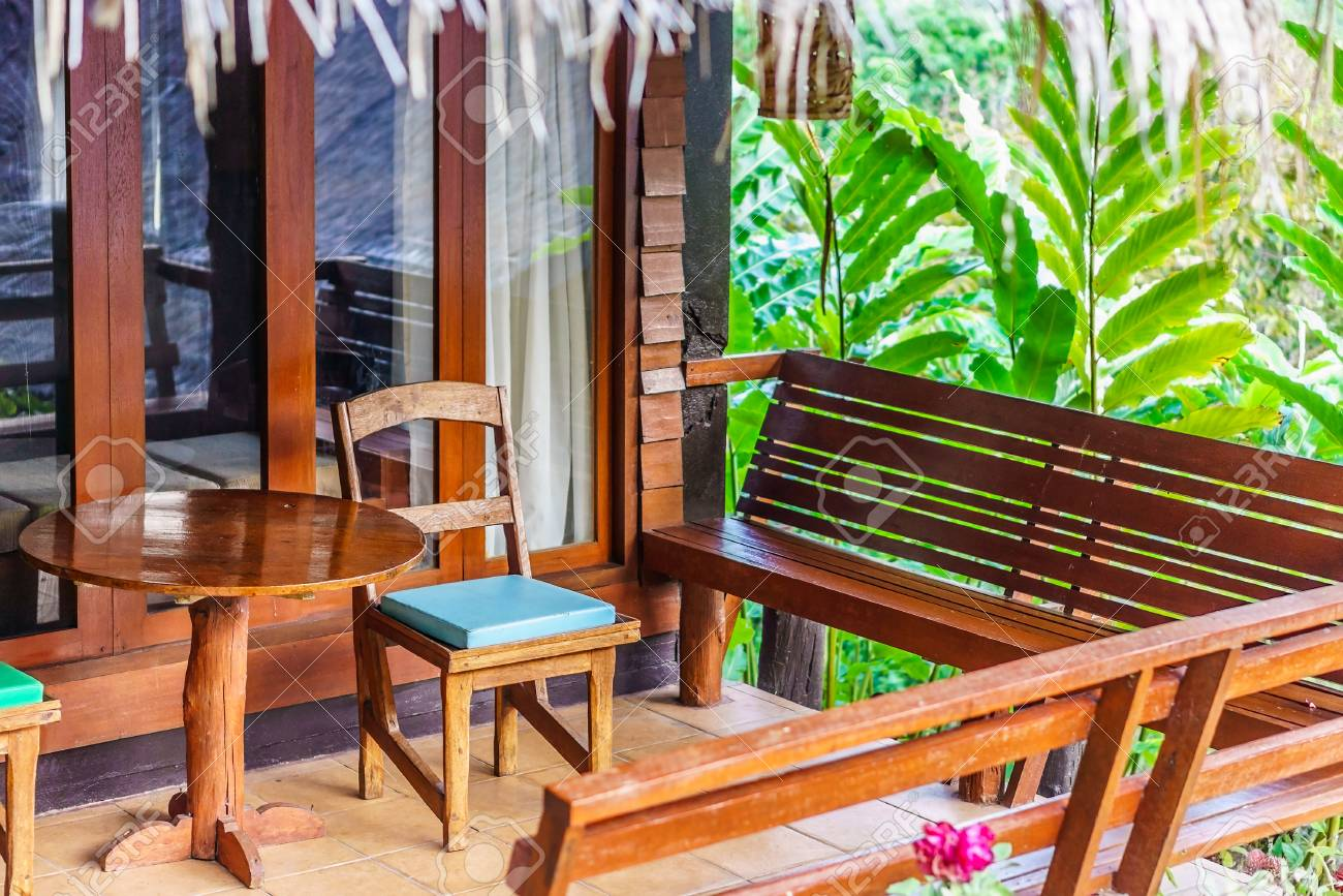 Stock Photo   Vintage Wooden Chairs, Benches And Table On A Home Porch.  They Are Traditional Furnitures In Thailand, Asia.