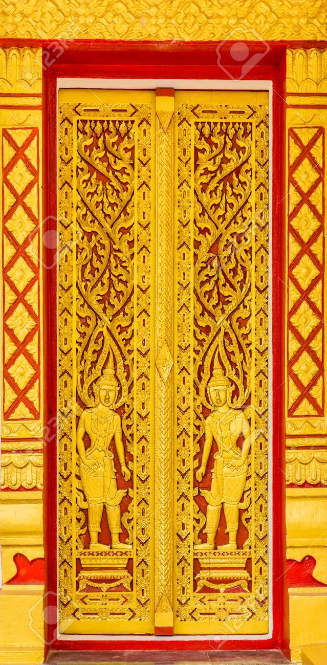 The door entrance of Buddhist temple is at Wat Tam Tua in Phang Nga province Thailand Southeast Asia.  sc 1 st  123RF.com & Vintage Deity Design On Ancient Carved Wooden Temple Doors. The ...