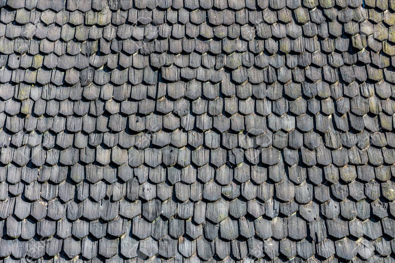 black pattern of vintage thai roof covering roofing materials are made of plates of wood - Roof Covering