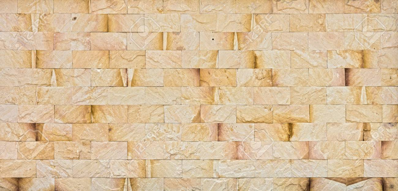 Natural Yellow Rock Wall. The Exterior Decoration Of Many Building ...