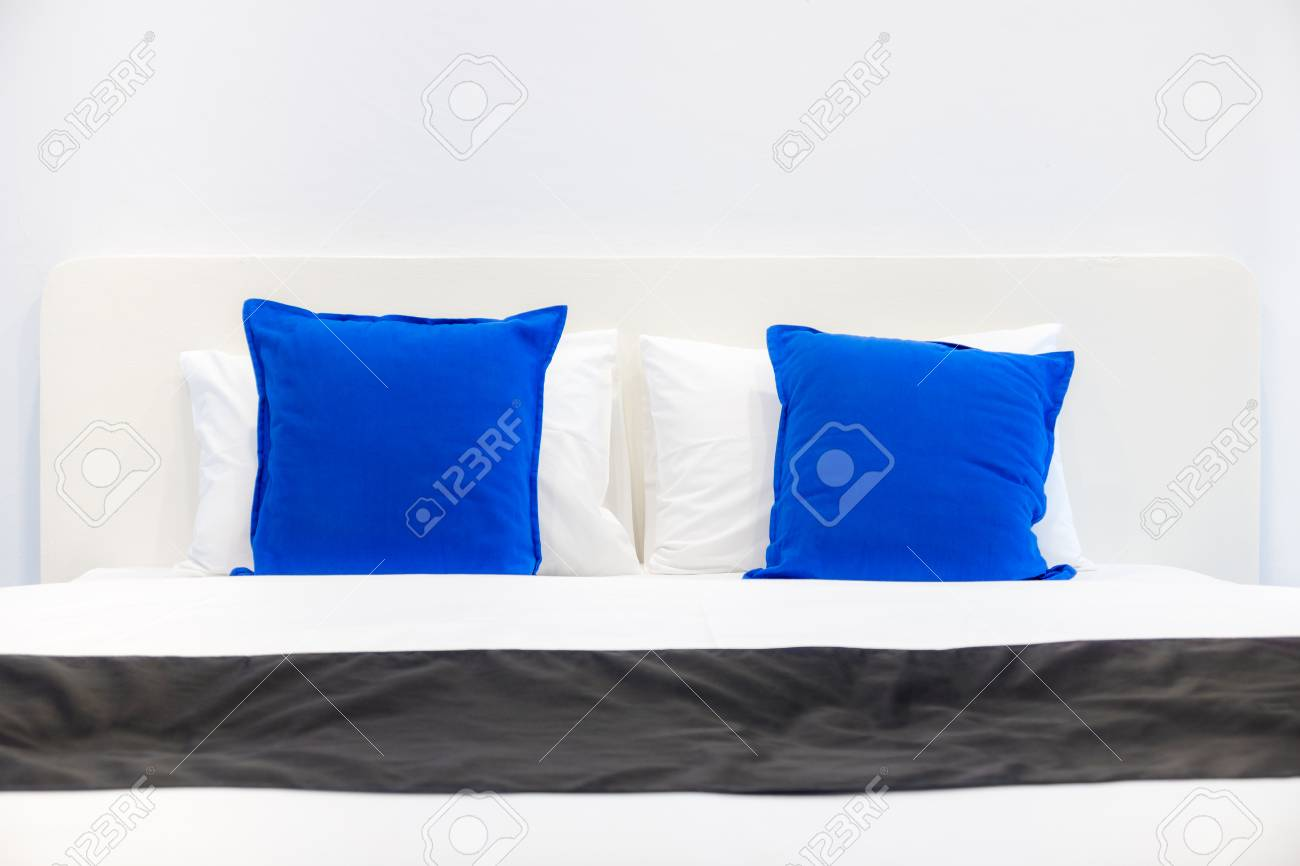 Front View Of White Pillows And Blue Cushions On Bed In A Bedroom Stock Photo Picture And Royalty Free Image Image 106917181