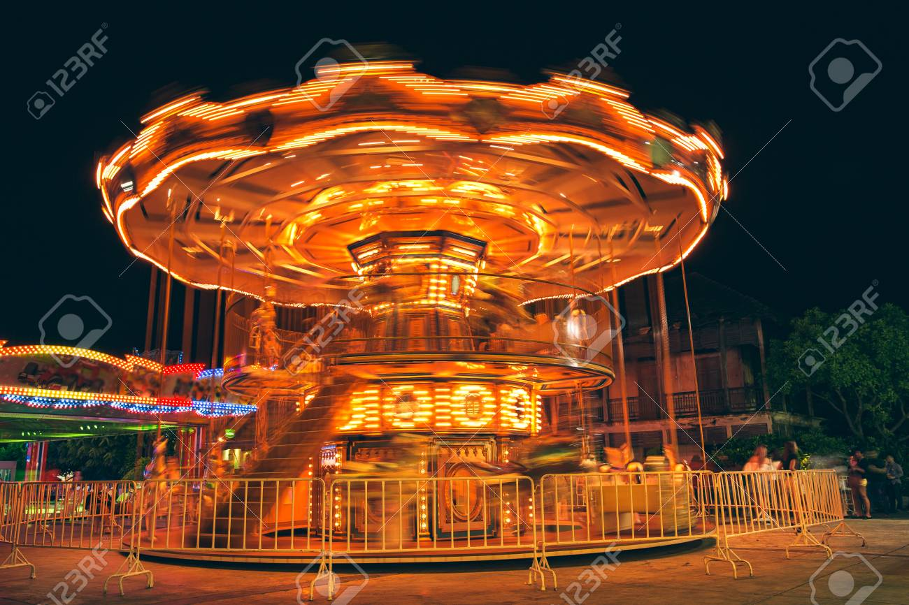 selective focus to some part flying horse carousel carnival stock