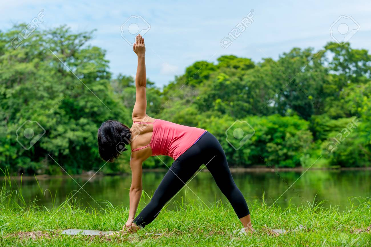 Asian Women Practicing Yoga In The Garden Background Stock Photo   35813519