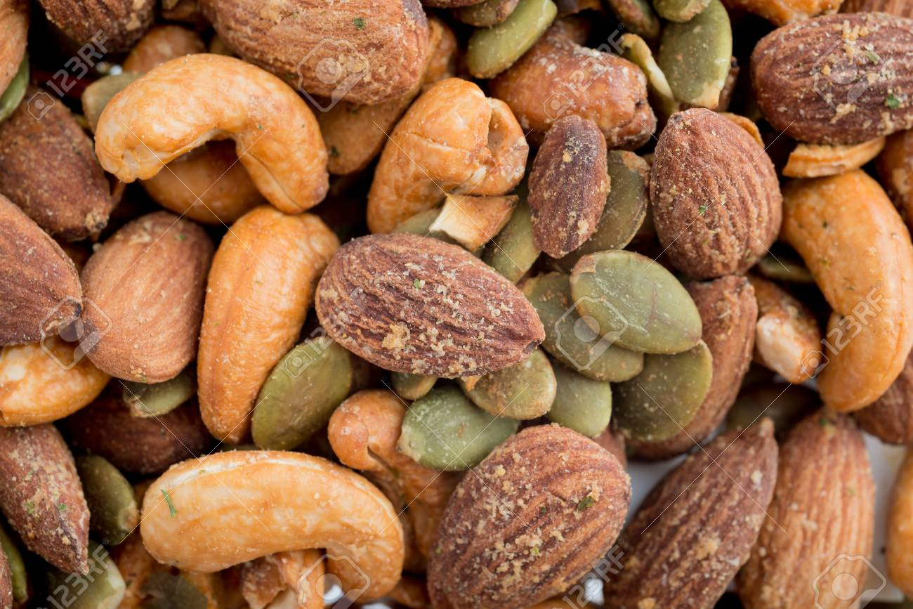 Roasted mixed nuts background texture