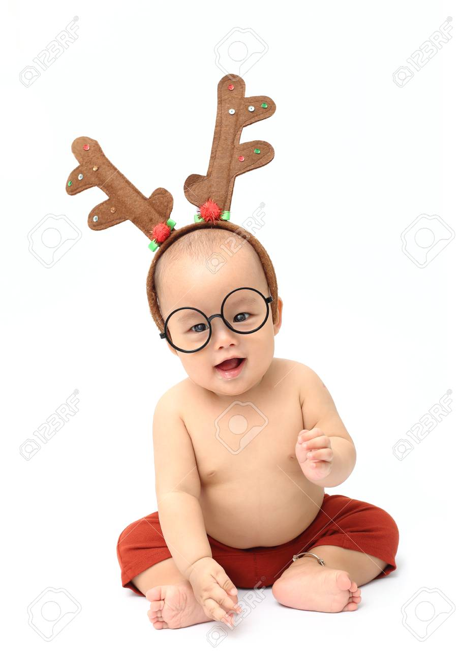 cute baby wear antler reindeer hair band and glasses isolated