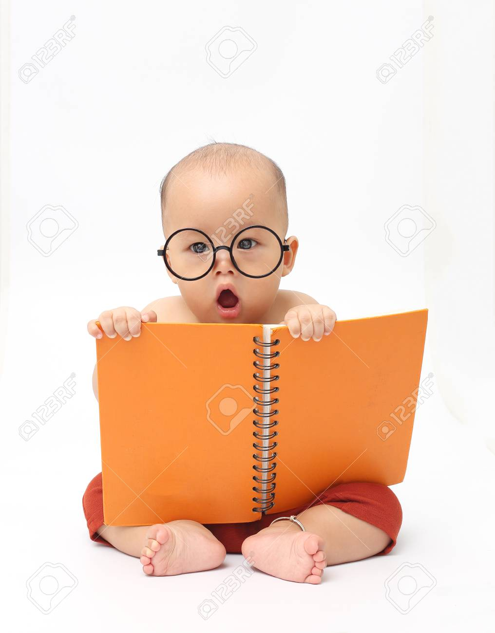 cute baby wear eyeglasses and reading big book stock photo, picture