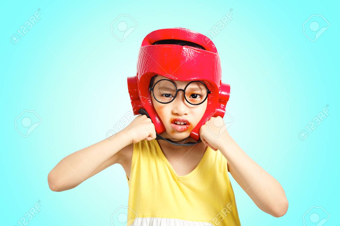 Little girl boxing action with headguard and injured face  Clipping