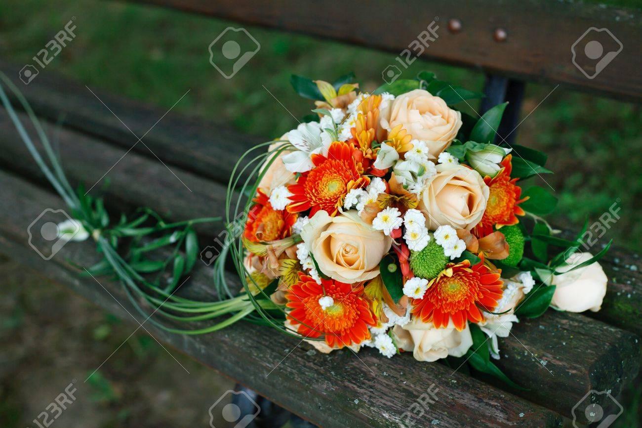 A wonderful bridal bouquet on a park bench. Stock Photo - 9828680