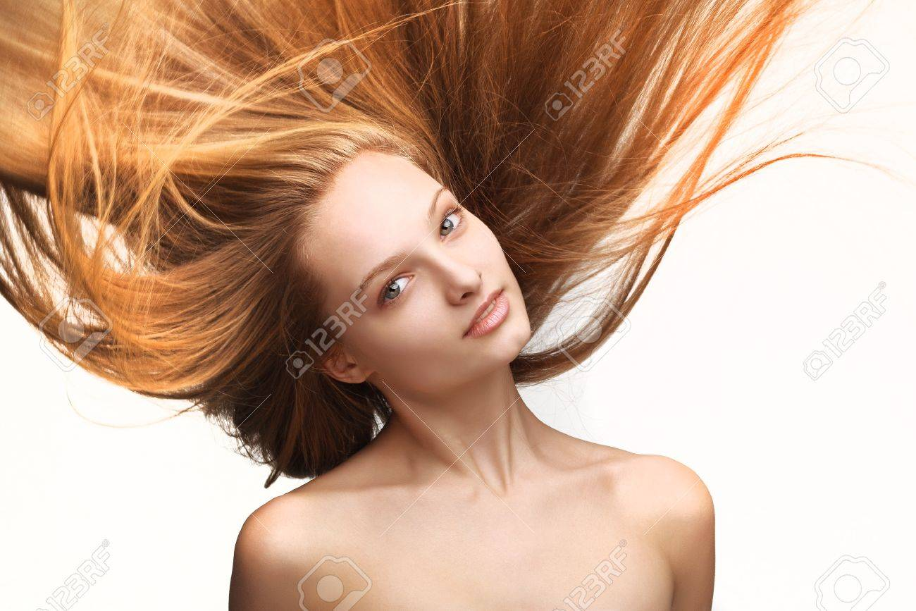 Pretty young girl with long flying hair on white background Stock Photo - 11854875