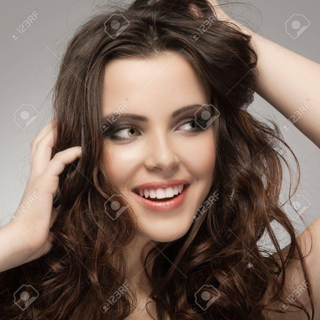 Very beautiful and happy woman hands in her hair pulling. Stock Photo - 12145489