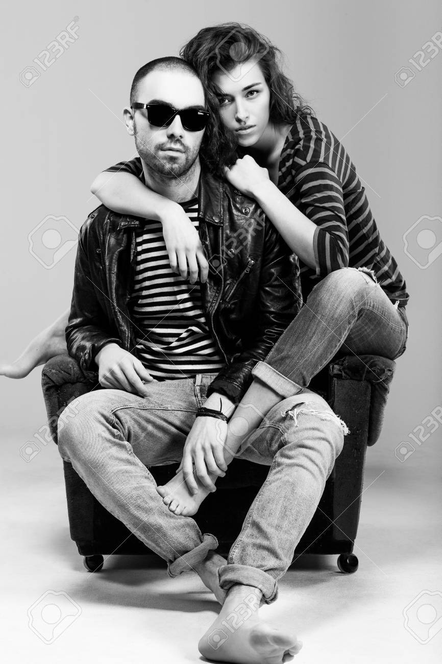 A beautiful young couple sitting in a chair Stock Photo - 12866436