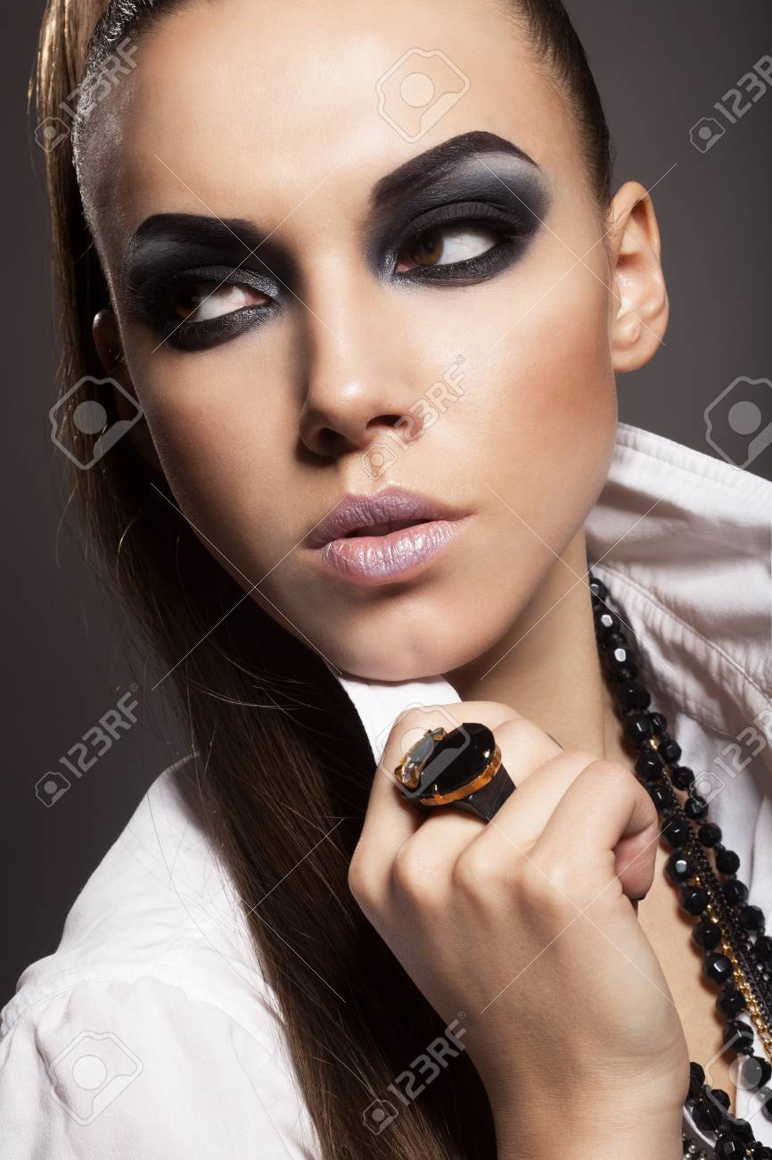 Sexy woman with long hair, make-up and smokey eyes Stock Photo - 17241058