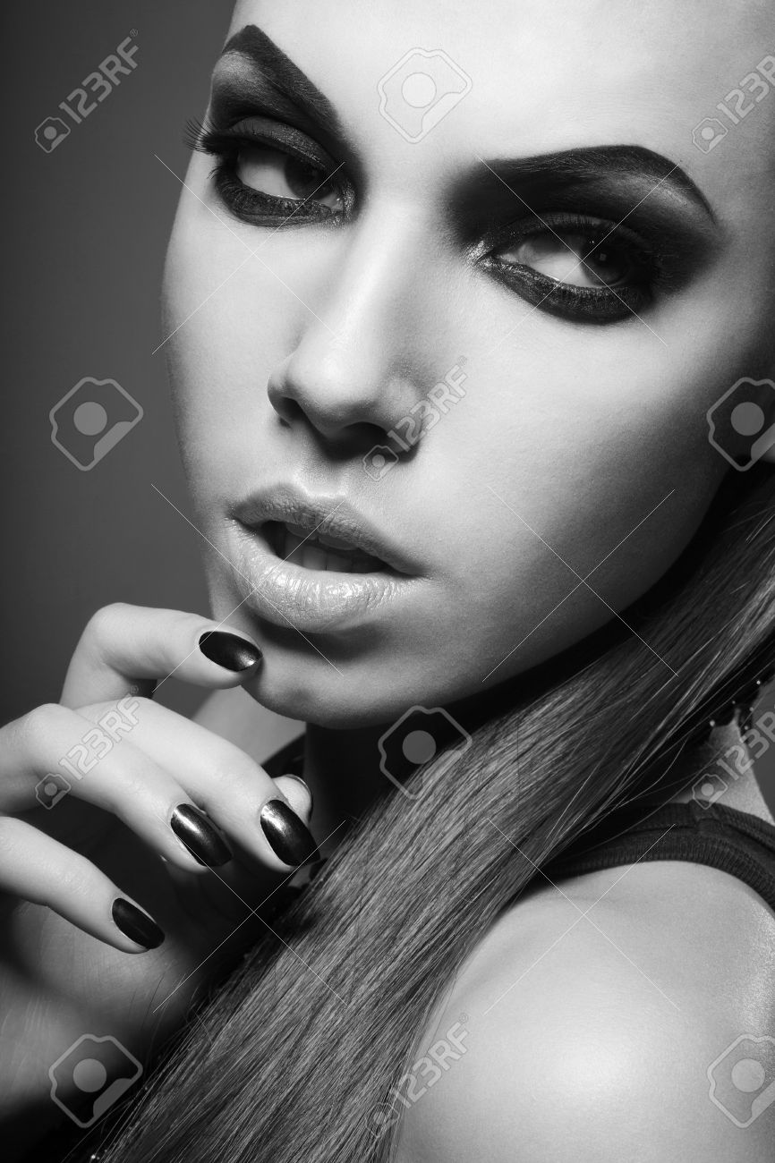 sexy woman with long hair, make-up and smokey eyes in black and white Stock Photo - 17241072