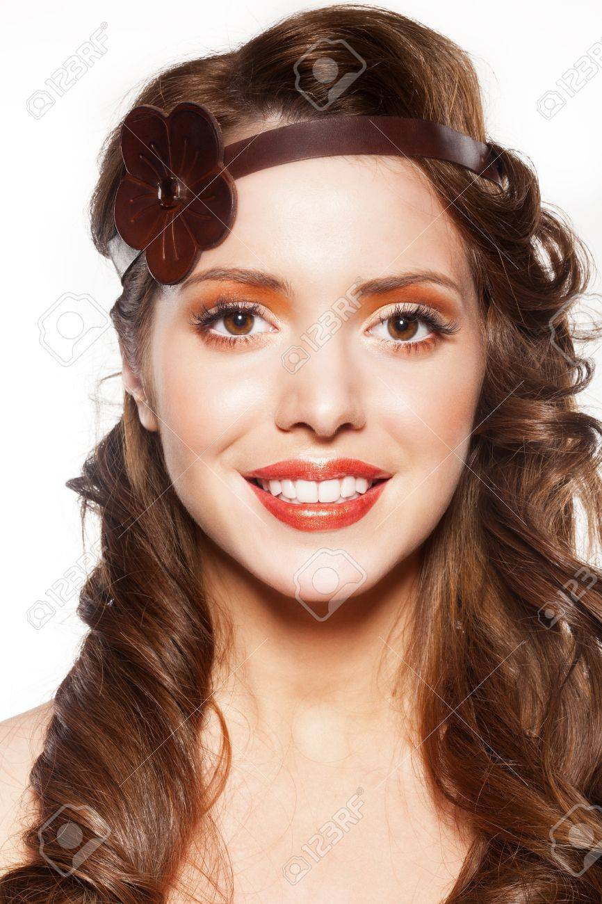 beautiful female face with make-up and shiny curly hair. Elegant hairstyle for long hair Stock Photo - 17329473