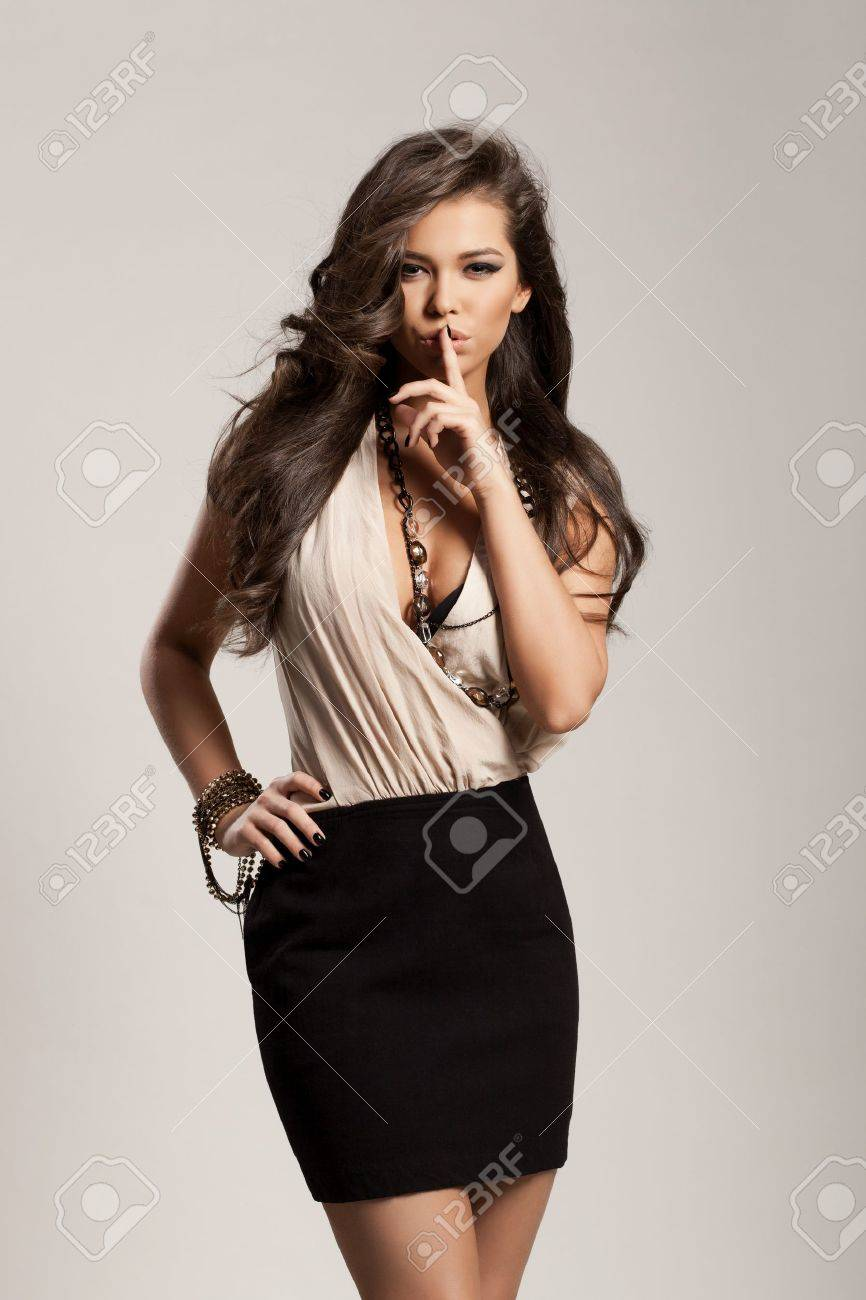 Portrait of a beautiful woman with healthy long brown hair and