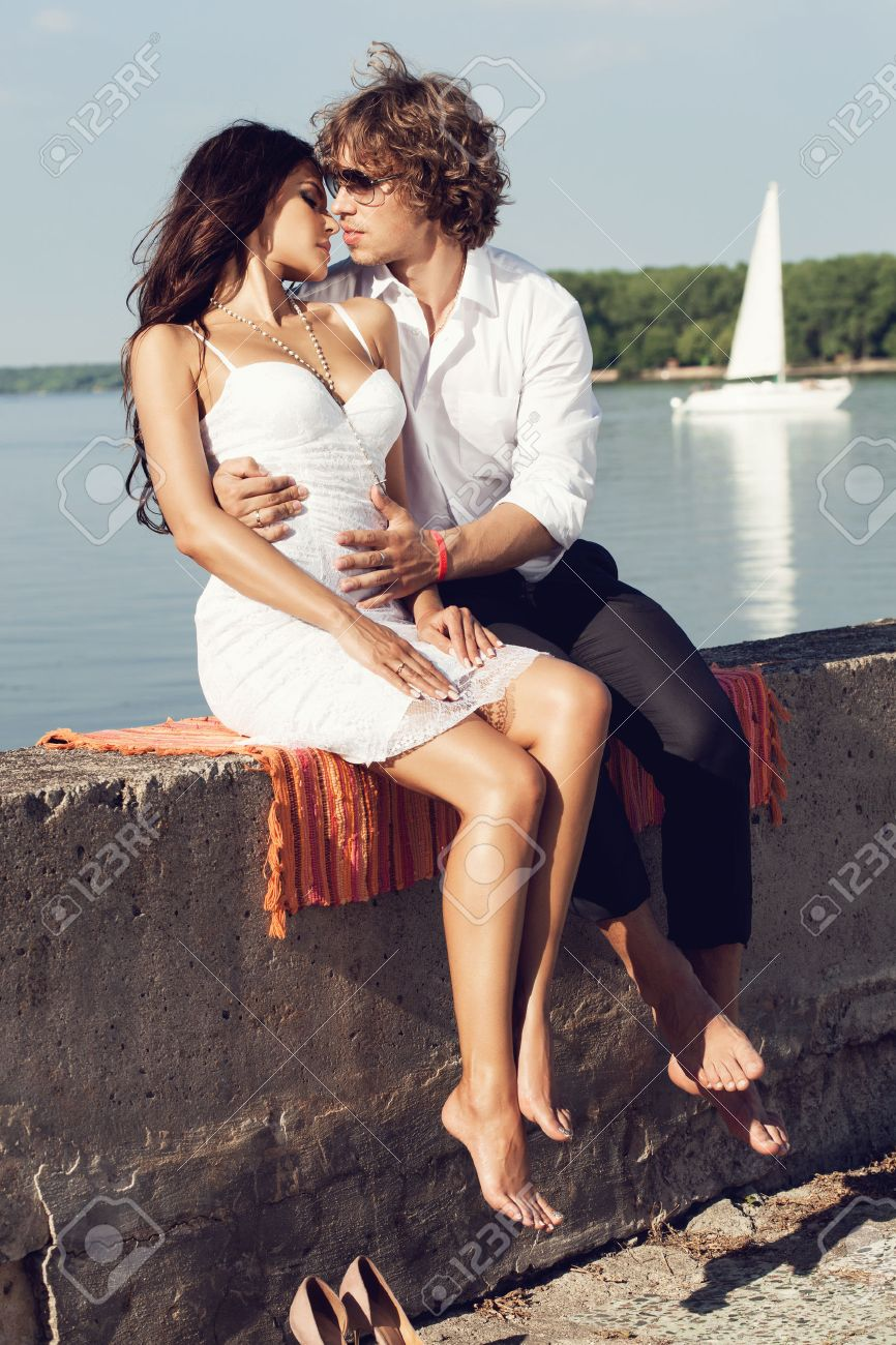 Sexy Lovely Couple Kissing In The Hot Sun On The Pier In Summer